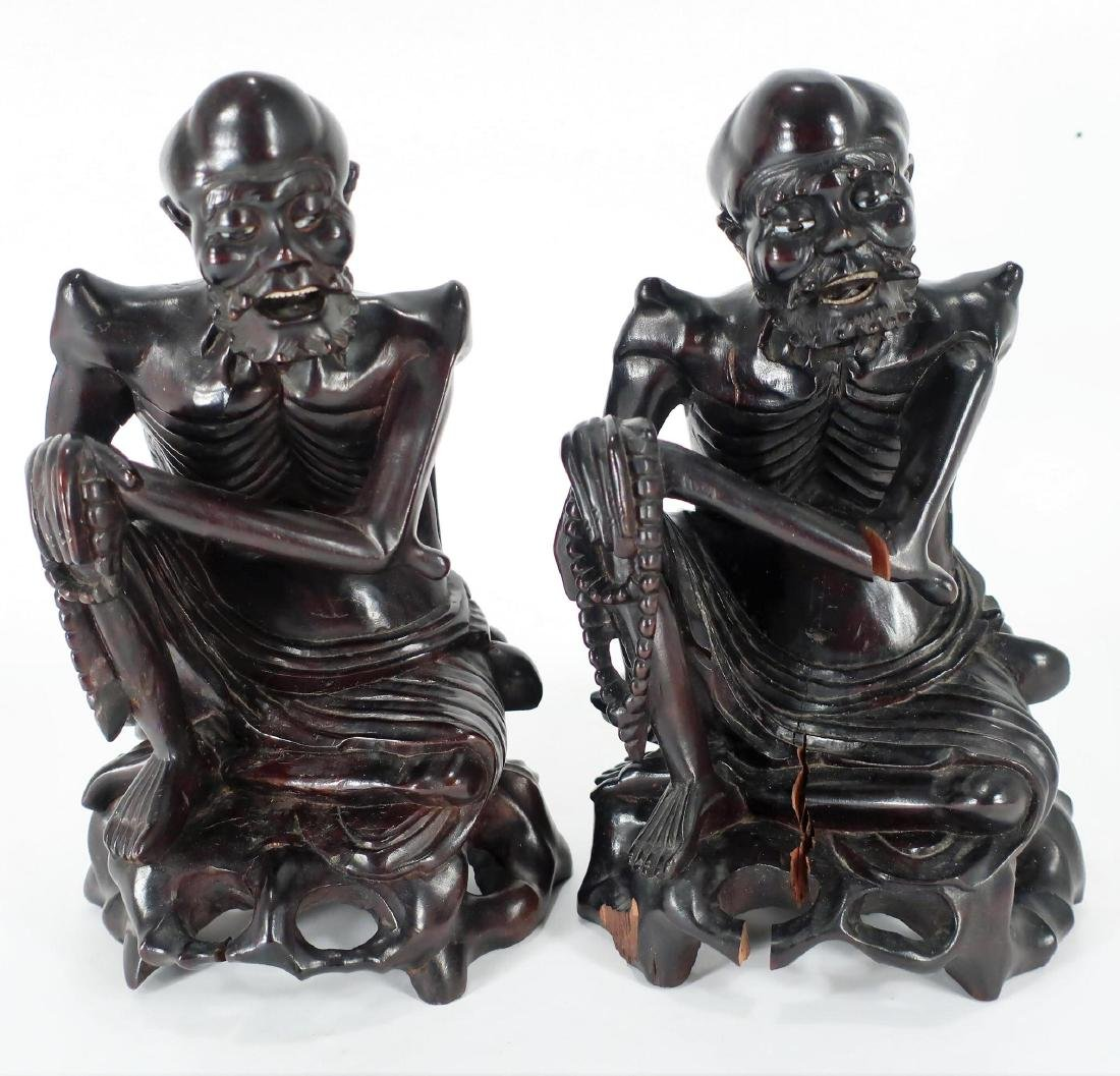 Two Carved Wood Asian Seated Figures