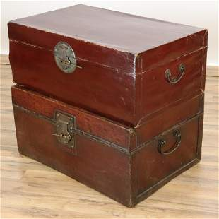 Two Similar Chinese Burgundy Leather Trunks