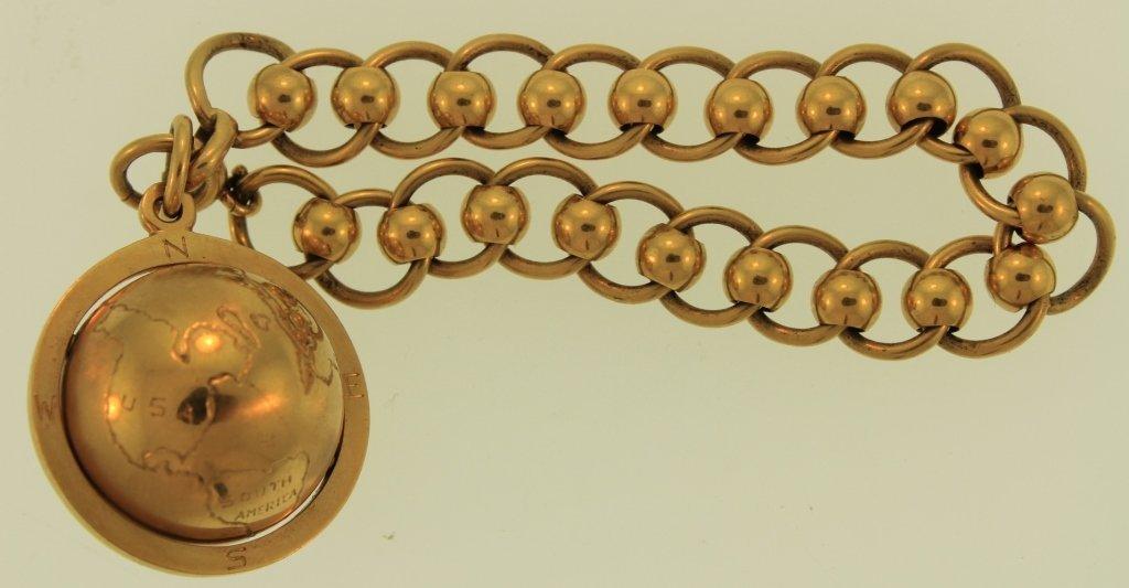 14K Gold Bracelet, w/Spinning Charm of the World