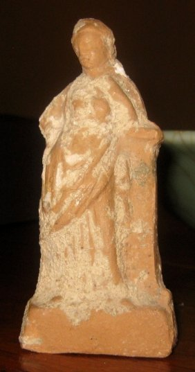 Ancient Pottery Figure of a Woman, c. 400 B.C.