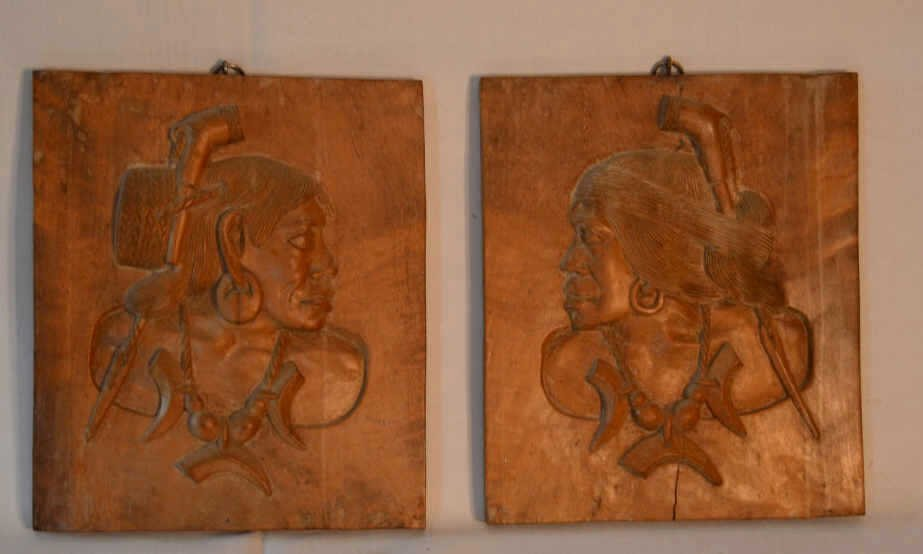 pair of wooden relief carvings