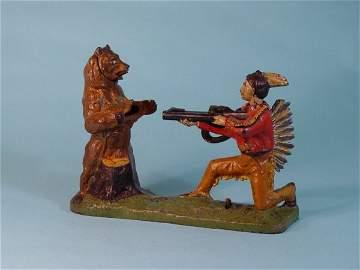 679: Indian and Bear Cast Iron mechanical bank