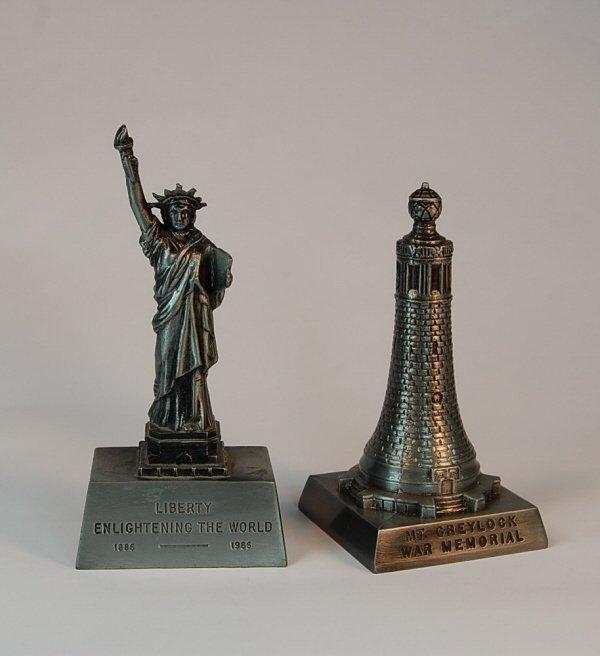 16: Pair of white metal monument banks