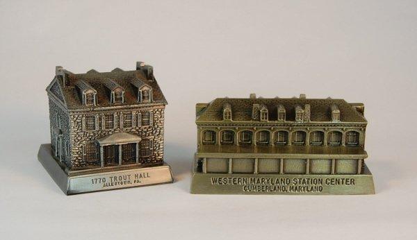 18: Pair of white metal building banks