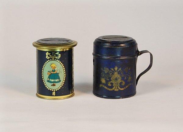 532: 2 Lithoed Tin banks: Stein, Cylinder.