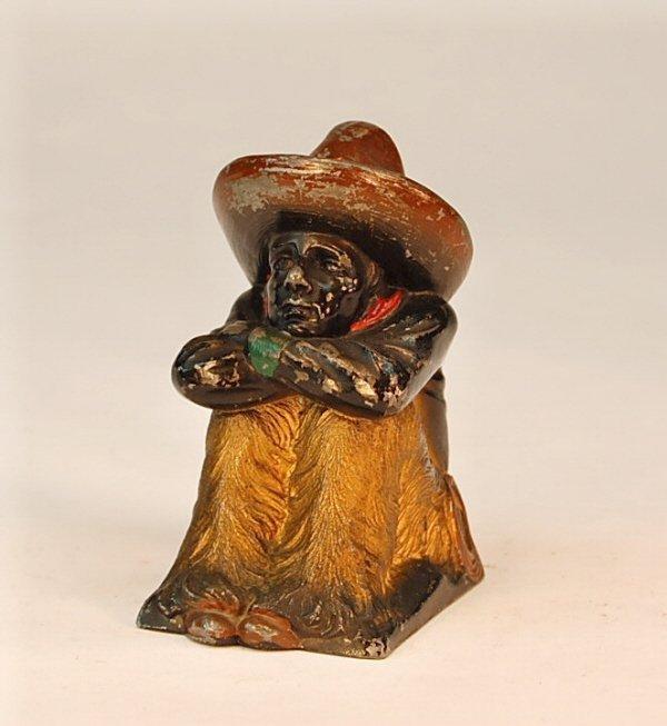 559: Seated Cowboy bank