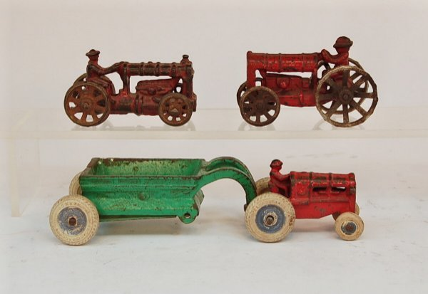 410: Lot of Three Farm Tractors, one with wagon
