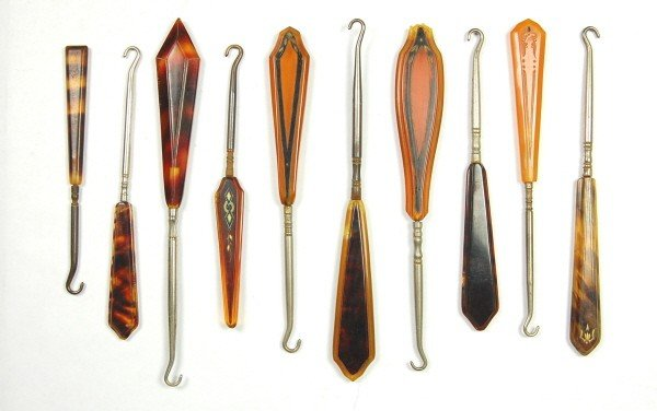 6: Lot of 10 Amber-colored Button Hooks.