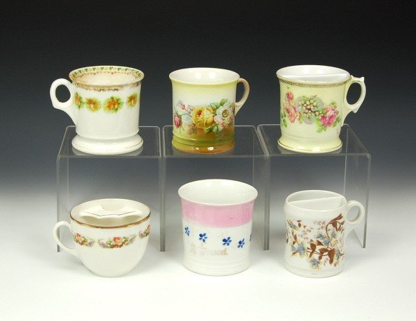14: Lot of 6 china Moustache cups.