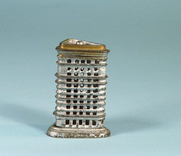 411: Tiny Flatiron Cast Iron Building Bank