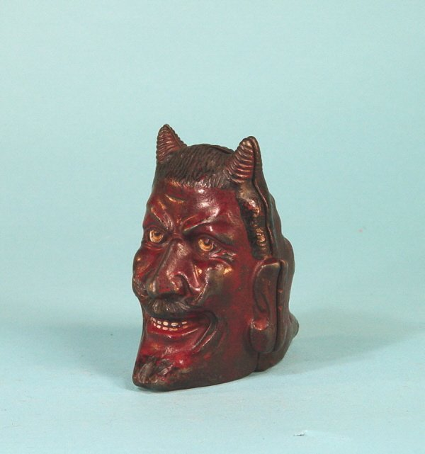 160: Two-faced Devil cast iron bank