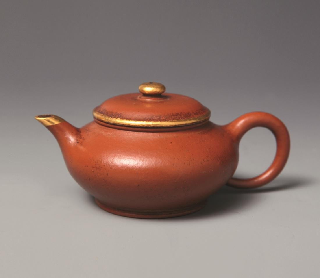 QING DYNASTY CLAY TEAPORT WITH GOLDEN