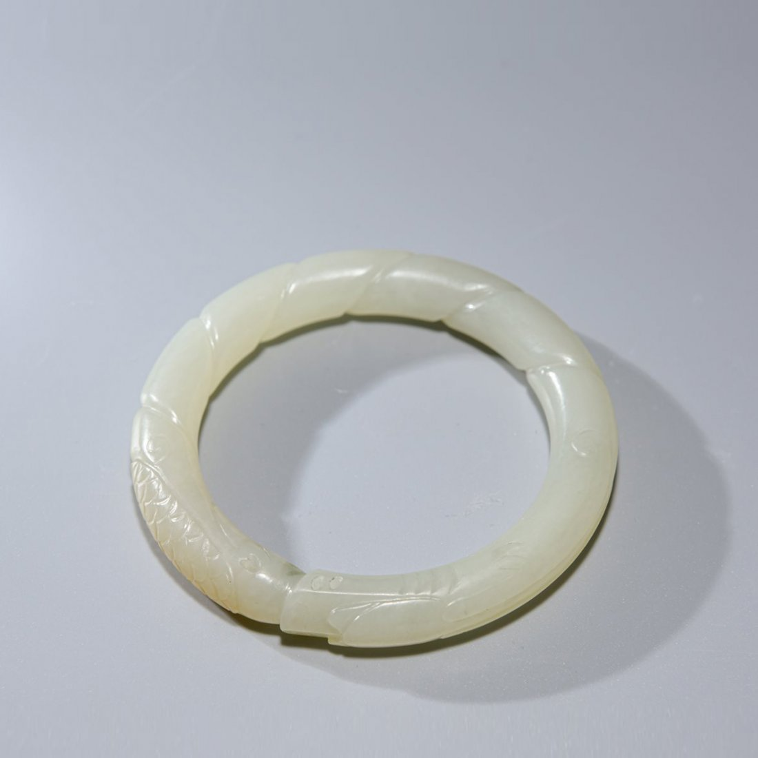 A Chinese White Jade Dragon Bracelet Qing Dynasty