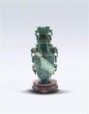A Chinese Taotie Pattern Spinach Jade Cover Vase Qing
