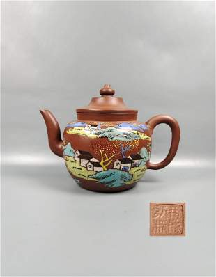 A Chinese Yixing Clay Landscape Teapot Mid Qing Dynasty
