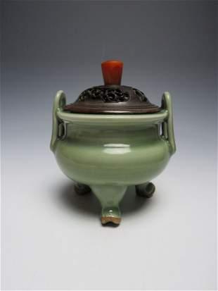A Chinese Celadon Glazed Tripod Censor Yuan Dynasty(127
