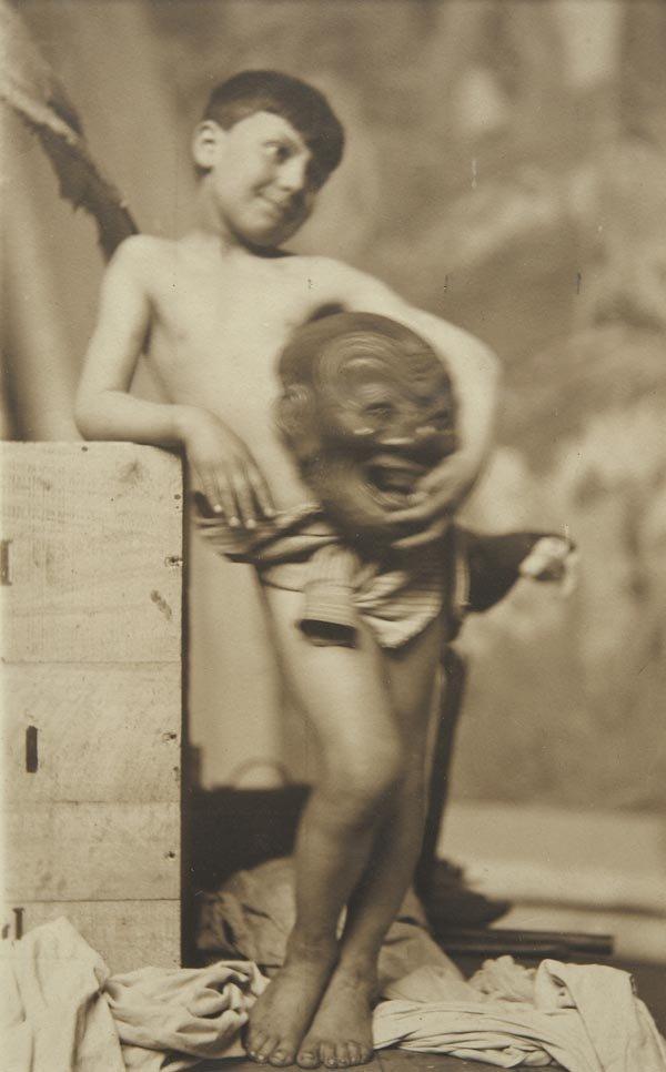 75:  FRANK  BRANGWYN  1867-1956  Study of a Boy Holding