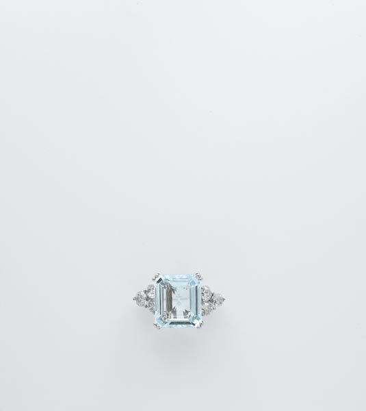 3:        An Aquamarine and Diamond Ring  Set to the ce