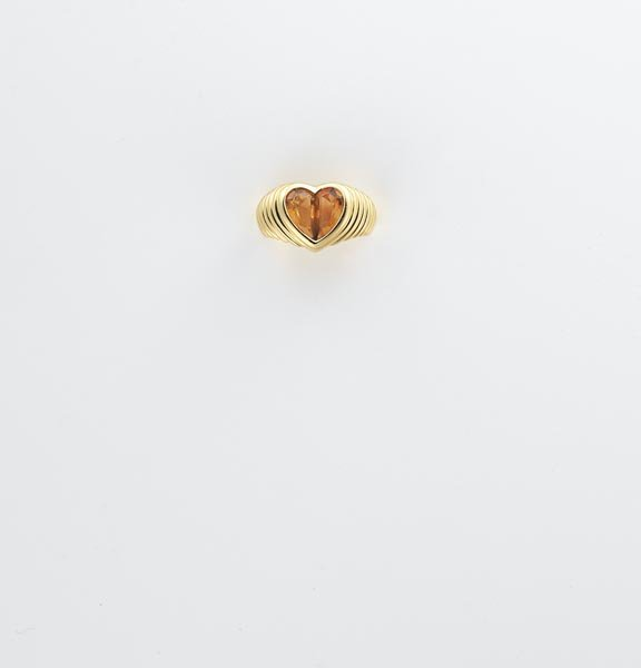 8:    BULGARI    A Gold and Citrine Ring   Set to the c