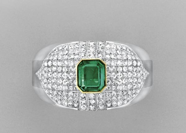 11:        An Emerald and Diamond Bangle  The wide tape