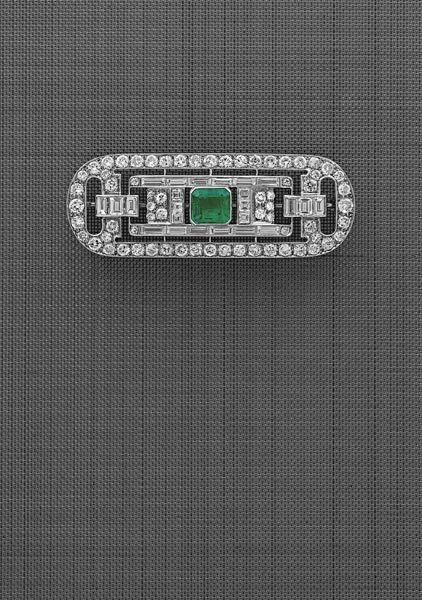 12:        A Diamond and Emerald Brooch  Of geometric d