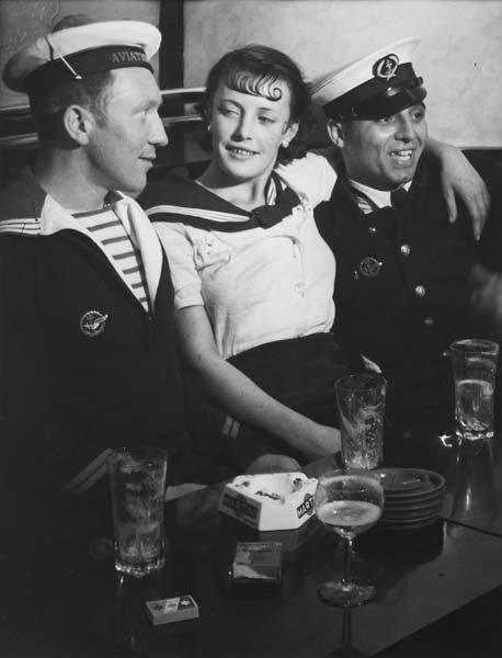 316: BRASSAI, 1899-1984 Conchita with sailors in a cafe