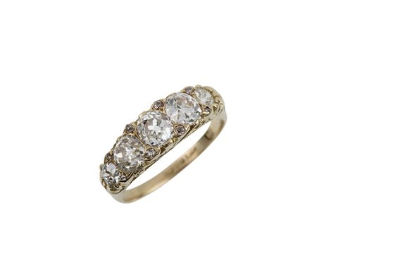 20:  A LATE VICTORIAN FIVE STONE DIAMOND HALF HOOP RING