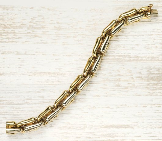 5: CARLO WEINGRILL, A Yellow Gold Link Bracelet