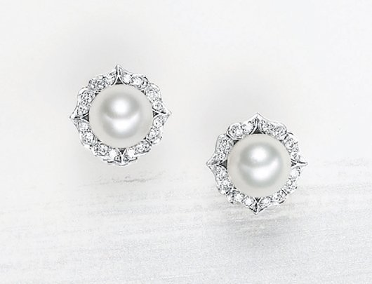 15: , A Pair of Cultured Pearl and Diamond Earrings