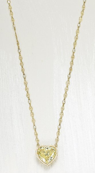 165: , A Magnificent Fancy Yellow Diamond Pendant Neckl