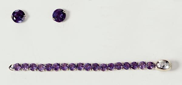 12: A PAIR OF AMETHYST EARSTUDS AND A DIAMOND AND AMETH
