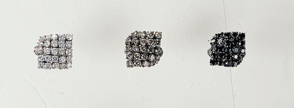19: THREE DIAMOND-SET CUFF LINKS - GAVELLO