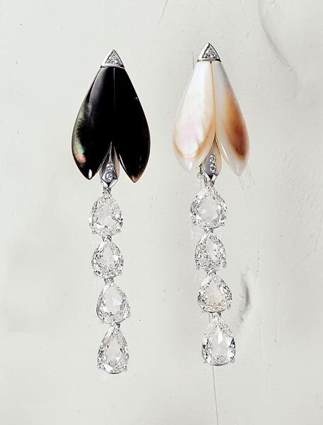 20: A PAIR OF DIAMOND AND MOTHER-OF-PEARL FIREFLY BROOC