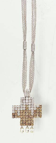 24: A WHITE AND BROWN DIAMOND CROSS PENDANT - GAVELLO