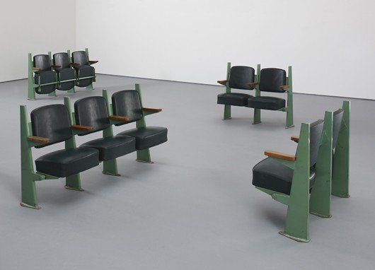 17: JEAN PROUVÉ, Row of two lecture hall chairs with ad