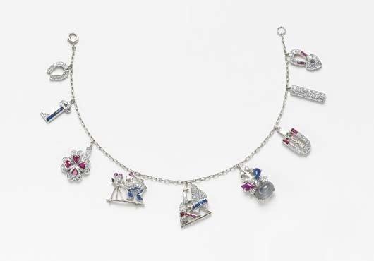 23: An Art Deco Diamond and Gem-Set Charm Bracelet, 192