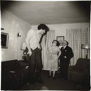 150: DIANE ARBUS A Jewish giant at home with his parent