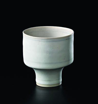23: LUCIE RIE, Small bowl with blue inlaid bands, c. 19