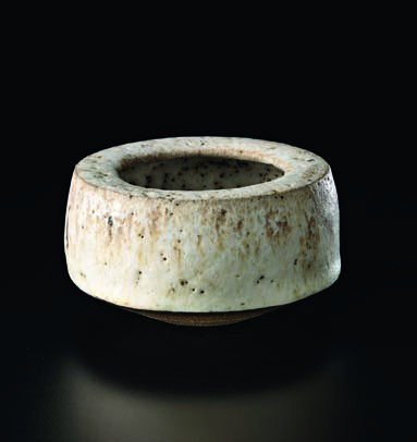 24: LUCIE RIE, Speckled white glaze pot with enclosed r