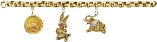16: VAN CLEEF & ARPELS, A Set of Three Gold Charms