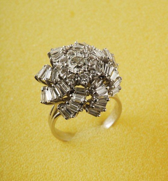 3:  A Diamond Cluster Ring, circa 1960 Of whorl design,