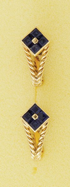 5:  A Pair of 1950s Sapphire Cuff Links The arched rope