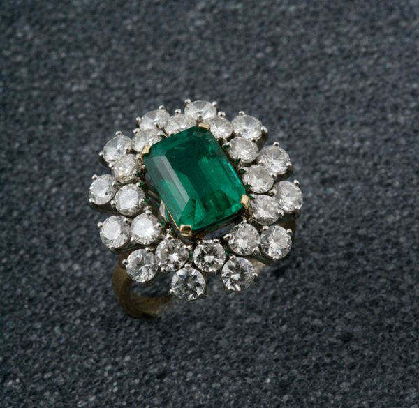 6:  A Fine Emerald and Diamond Cluster Ring The central