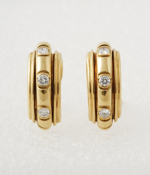 12:  PIAGET A Pair of Diamond–Set Ear Clips Each