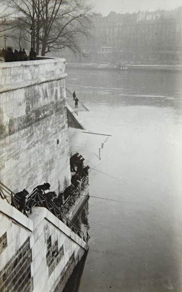 2: ANDRÉ KERTÉSZ, Fishermen Behind Notre Dame, Paris, 1