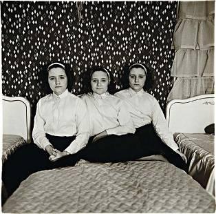 73: DIANE ARBUS, Triplets in their bedroom, N.J., 1963