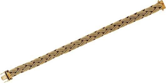 9: A Gold Bracelet.