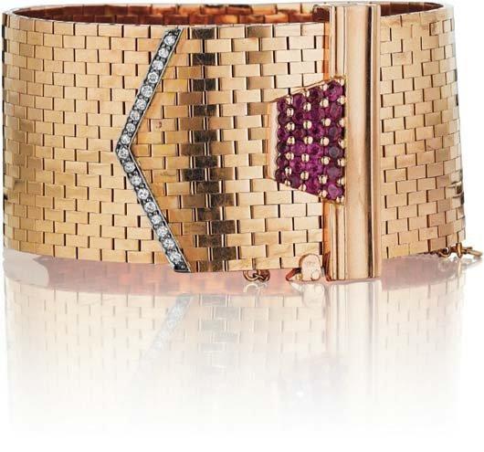 18: A Retro Gold, Diamond and Ruby Buckle Bracelet.