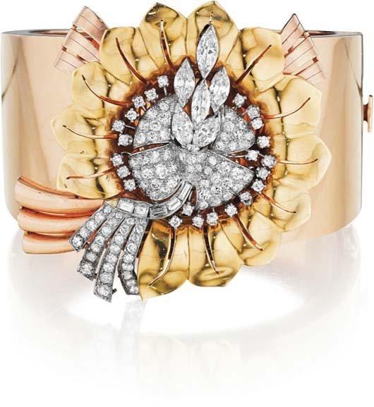 20: A Diamond and Gold Brooch Bangle Bracelet.