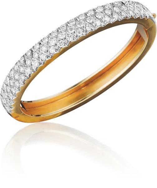 21: A Gold and Diamond Bangle, 1970.
